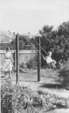 Margaret and Christa on the swing at Ridley Street about 1956