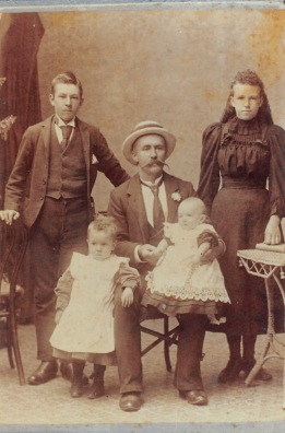 John Young with his step children Bob and Mary Whiteman and his sons Jack and Cecil Young. Photograph taken 1898-9. A copy of this photograph came from the Tunks family (relatives on the Young side) but a copy is also held by the Way family (relatives of the children's mother).
