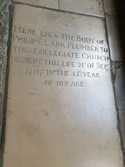 memorial to Philip Clark plumber in cloisters
